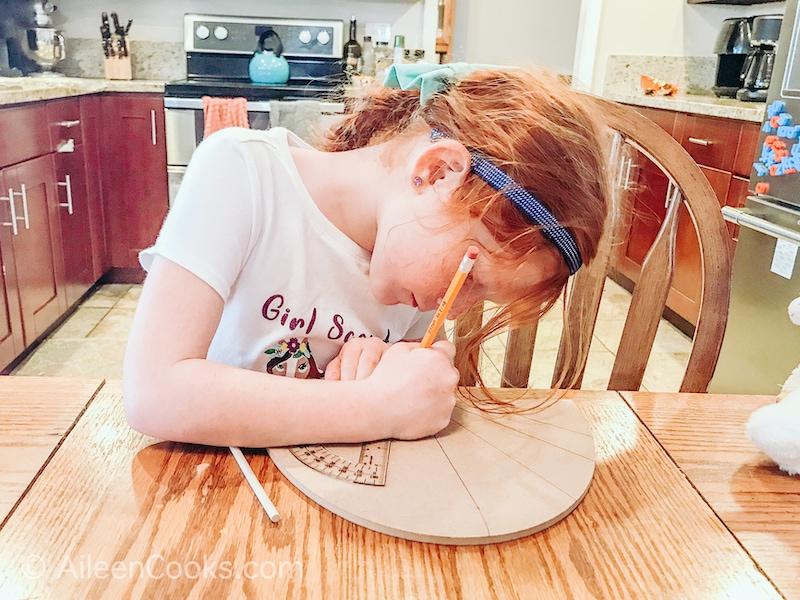 A girl designing a sundial.