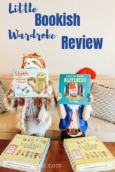 "Two girls dressed in costumes and holding children's books in front of their faces with the words ""Little Bookish Wardrobe Review"" in blue lettering above their heads."