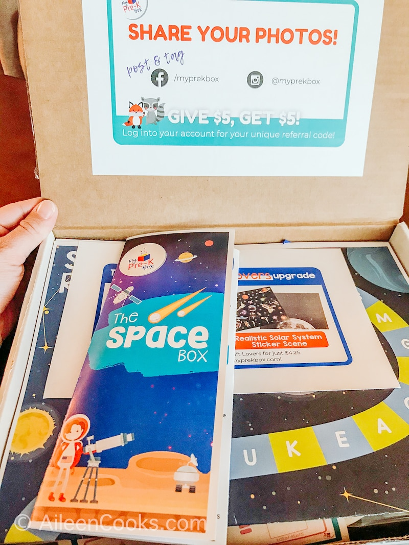 """The inside flap of the My Pre-K Box with a sticker that says """"share your photos!""""."""