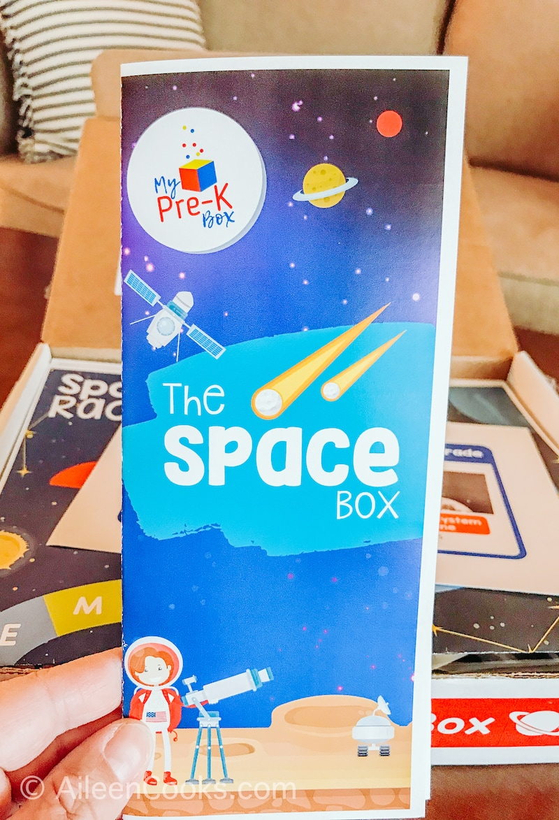 """A blue pamphlet that says """"The Space Box""""."""