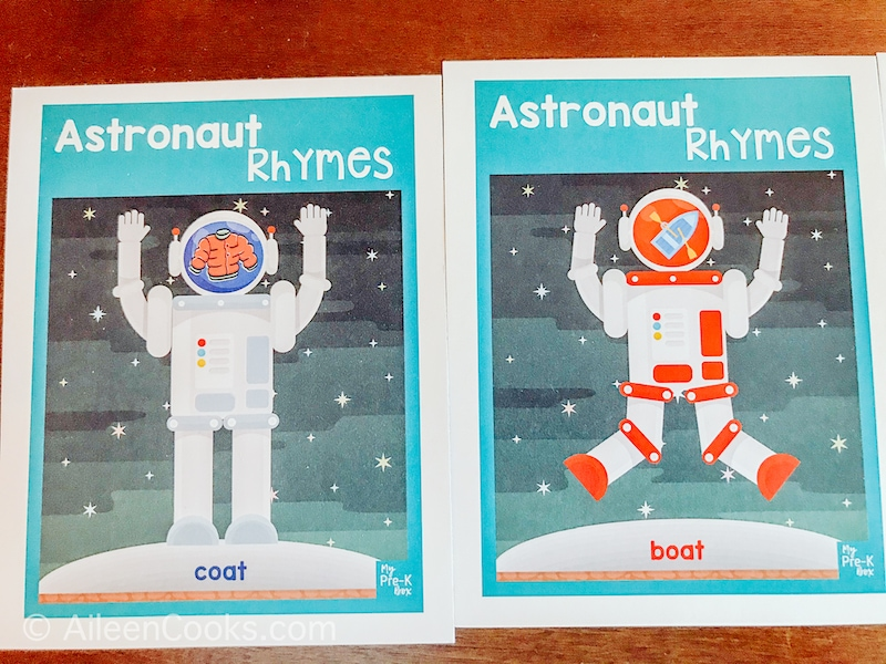 Two astronaut cards with rhyming words listed on the bottom.