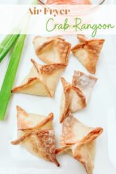 "Fried wontons on a plate with the words ""air fryer crab rangoon"" in brown and green lettering."
