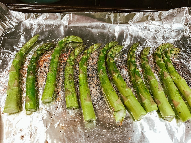 Asparagus drizzled with olive oil and spices.