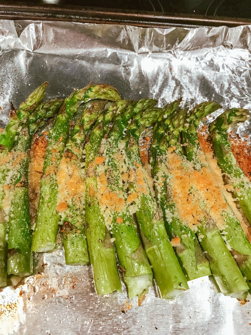 Asparagus topped with melted parmesan cheese.