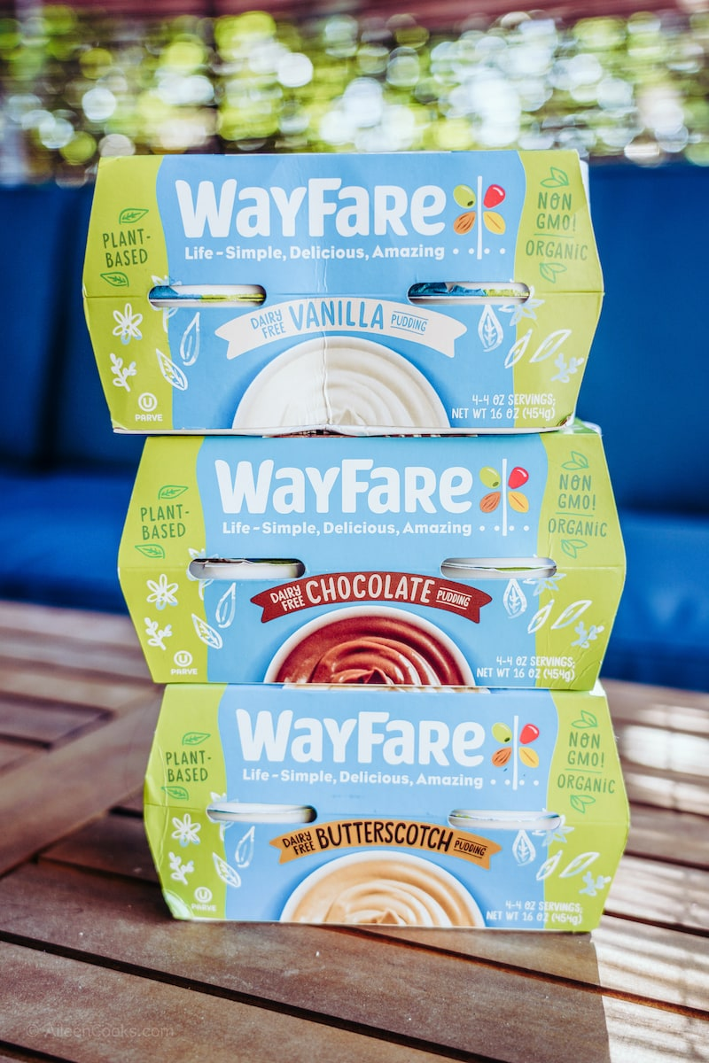 A stack of three four packs of Wayfare pudding.