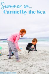 Two kids digging in the sand at Carmel Beach.