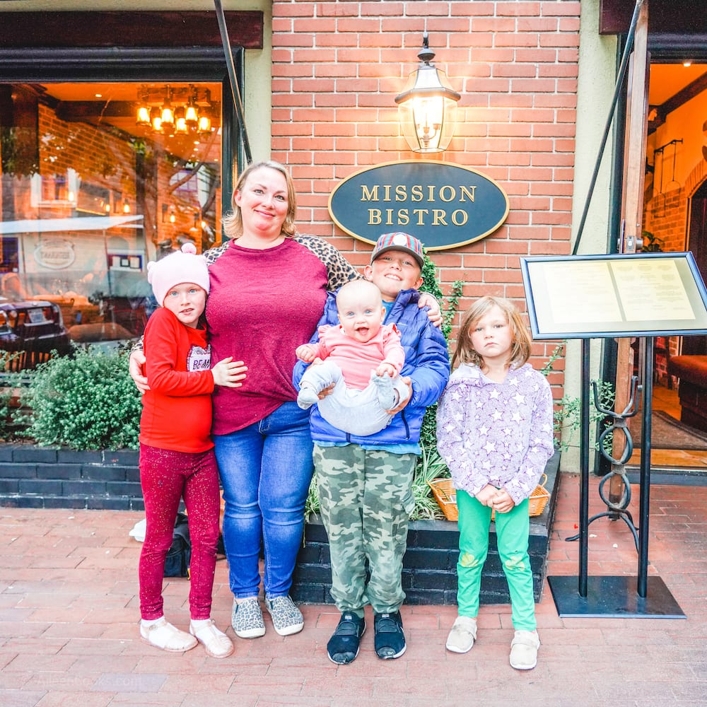 A mom and four children standing in front of Mission Bistro in Carmel.