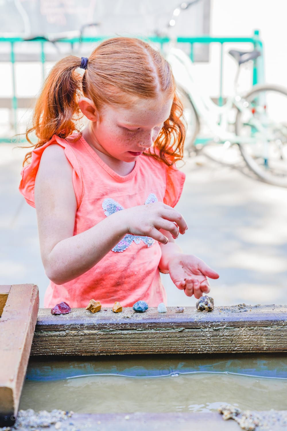 A girl lining up the gems she mined at Tower Park in Lodi, CA.