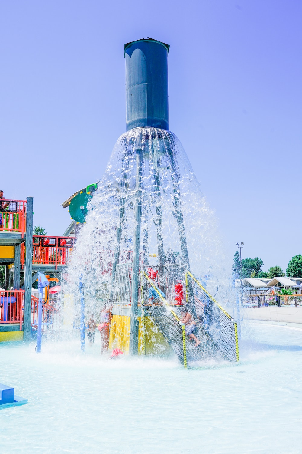 A large water feature pouring water out over a water playground at Tower Park in Lodi.